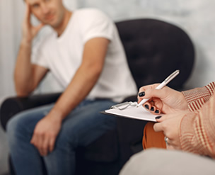 Adult being counseled by a Therapist