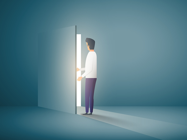 Man opening door to outside light